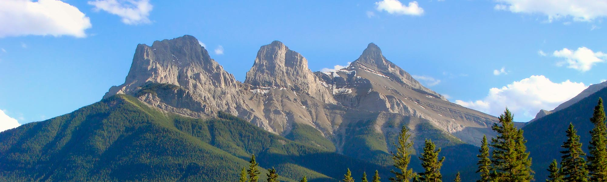 The iconic Three Sisters mountain range in Canmore, Alberta