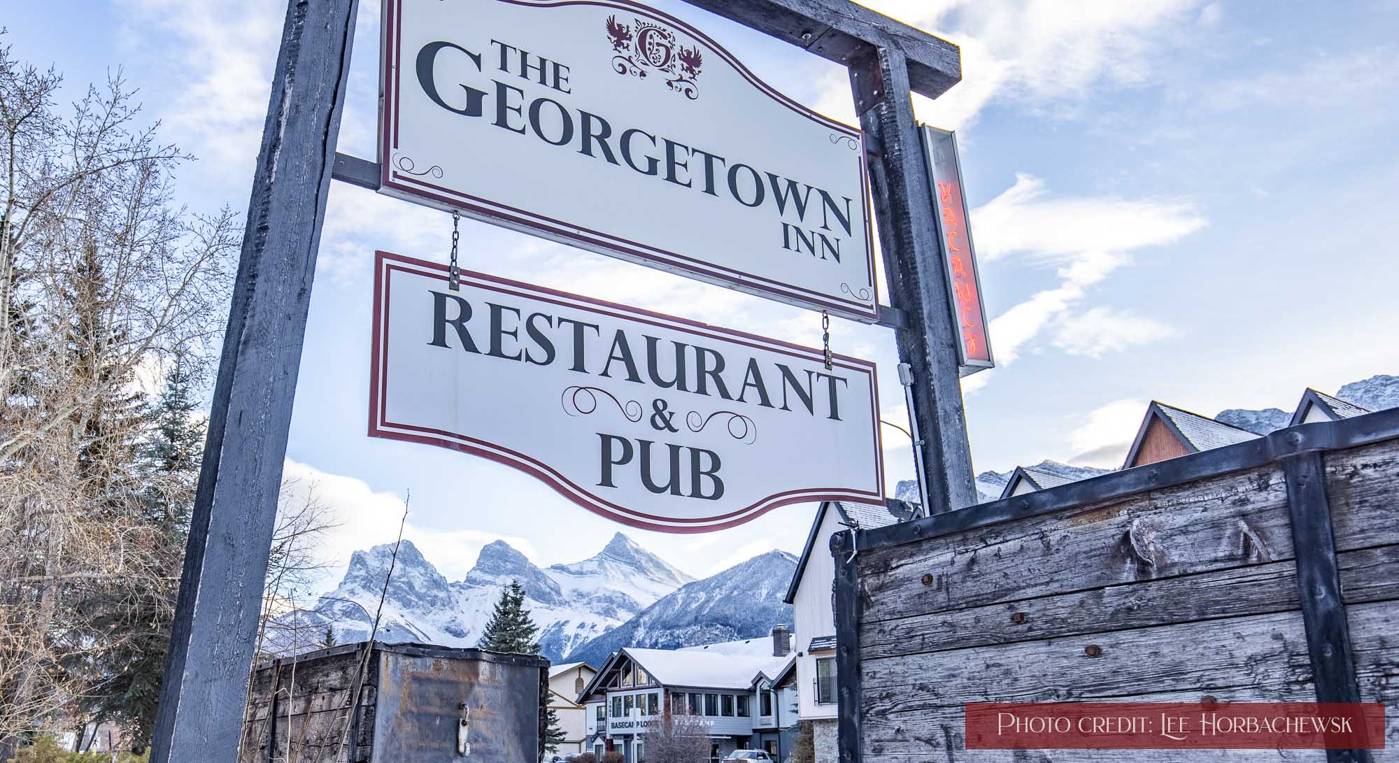 The Georgetown Inn's exterior sign in winter.